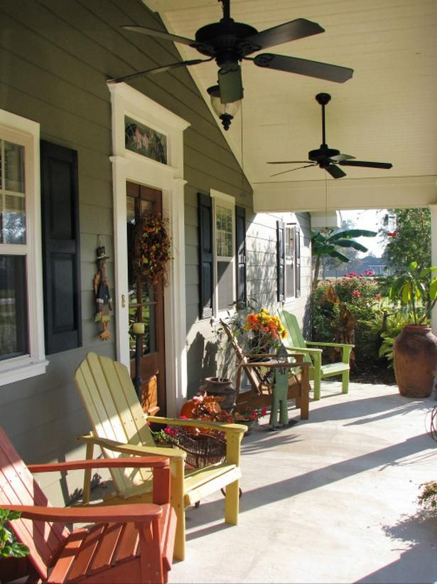 porch with different-colored Adirondack chairs