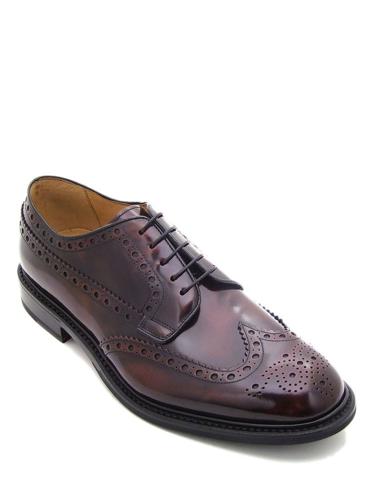 #Laceup #shoe in calfskin brown leather. Featuring plain upper and leather sole. #Brogue #style detailing with perforated floral design on the toe. Its authentic character makes it ideal for everyday wear with a casual #style.