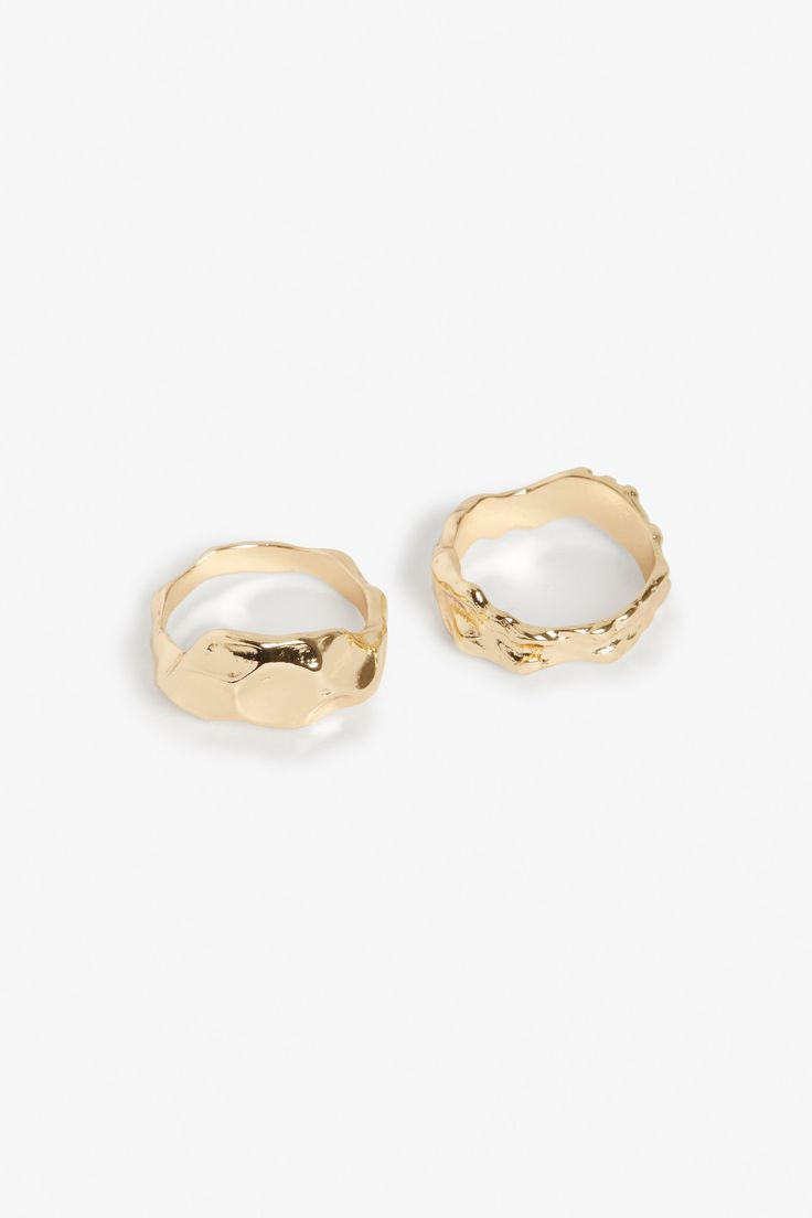 Set of rings inpsired by softly fluid organic shapes and rocklike formations. Wear nature on your fingers, as a set or as separates.