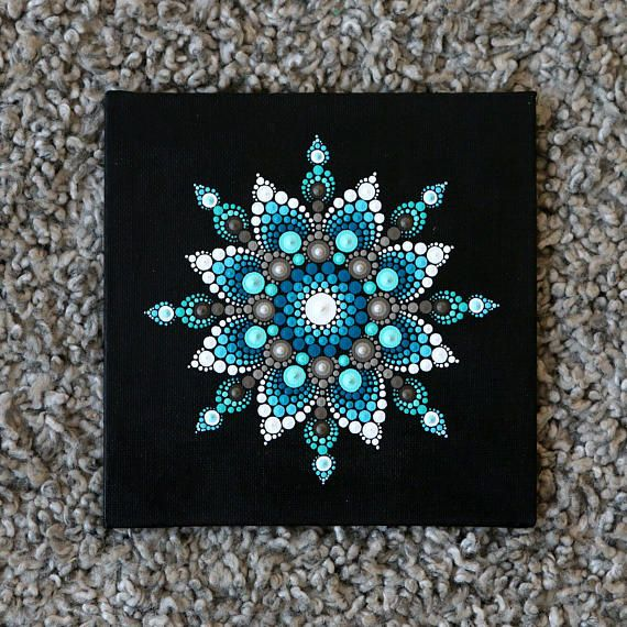 Canvasboard of 0.4 mm thick painted with acrylic paint with mandala. The size is 15 x 15 cm. The idea with dots en mandala is inspirited by Elspeth McLean. Shipping the painting within 1-3 days with Track & Trace code. Colors on the pictures can deflect from reality. This because every