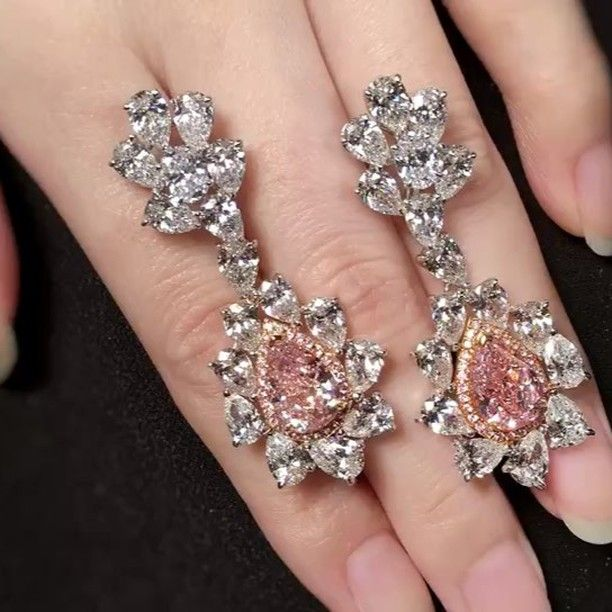 A spectacular pair of beauties. Fancy Intense Pink diamond earrings. A pair to be proud to own and cherish.