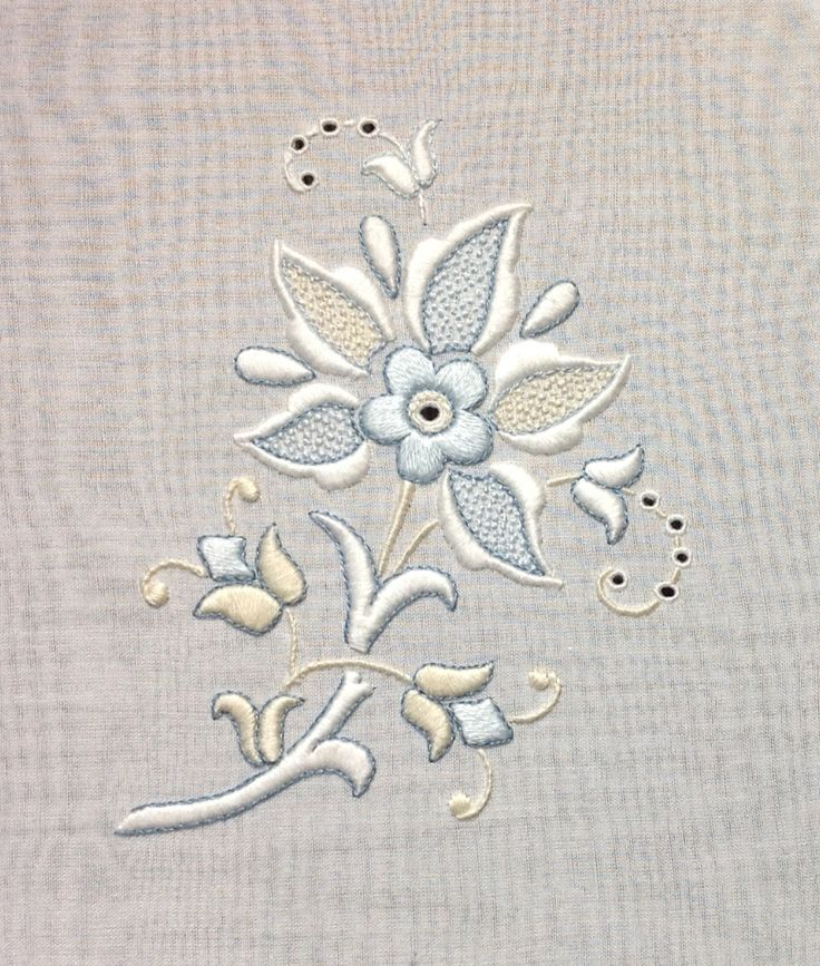 Whitework with blue and ecru accents stitched by trish burr
