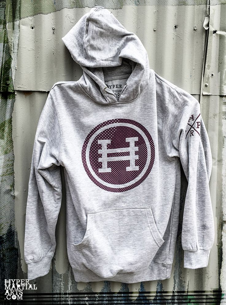 A new take on a classic Hyper Halftone Design. Purple full front circle H Logo on front and left arm badge. Cozy front pouch pocket. Grey Heather 8.5oz mid-weight classic hoodie. 75% Ring spun cotton and 25% polyester. Printed in USA.