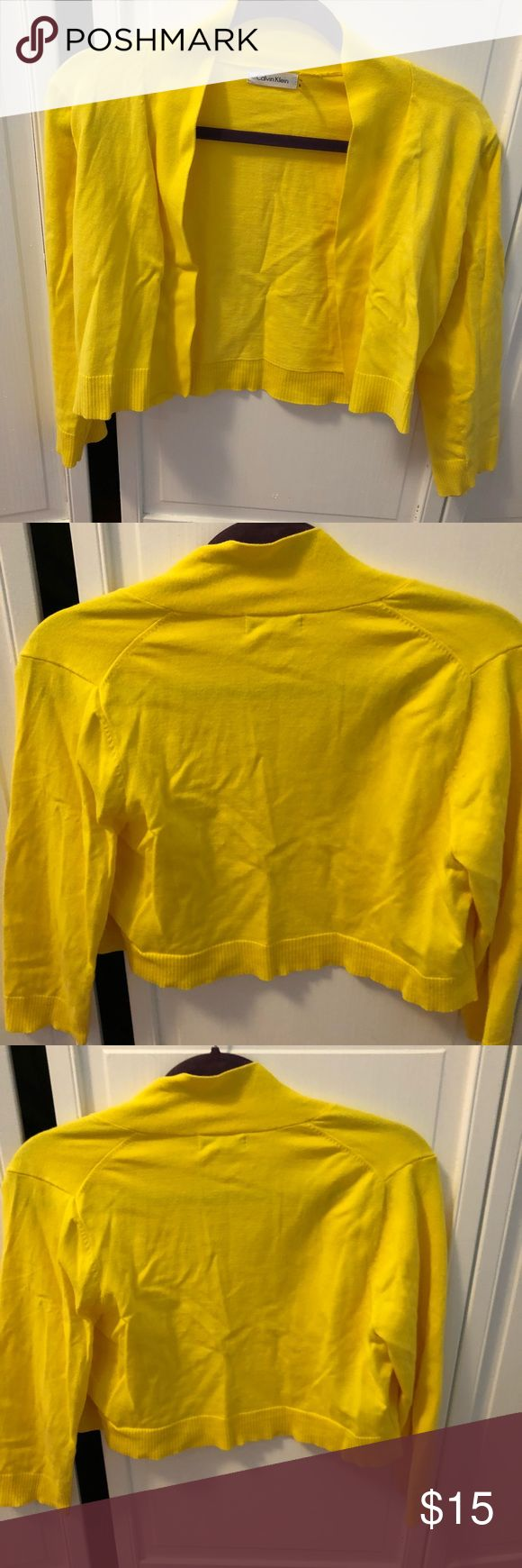 Calvin Klein yellow shrug Calvin Klein shrug, size medium. Only worn once.  It's a bright yellow, 76% cotton 24% nylon.  It's stretchy but is sturdy so won't get stretched out. Calvin Klein Sweaters Shrugs & Ponchos