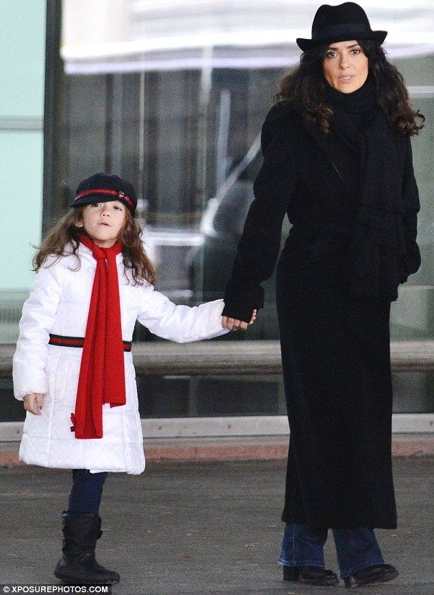 Mini-me: Salma Hayek's daughter Valentina is looking more like her mom every day as the pair arrive in style in Paris on Friday