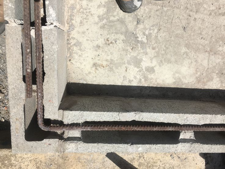 Reinforcing bars between the courses of blocks