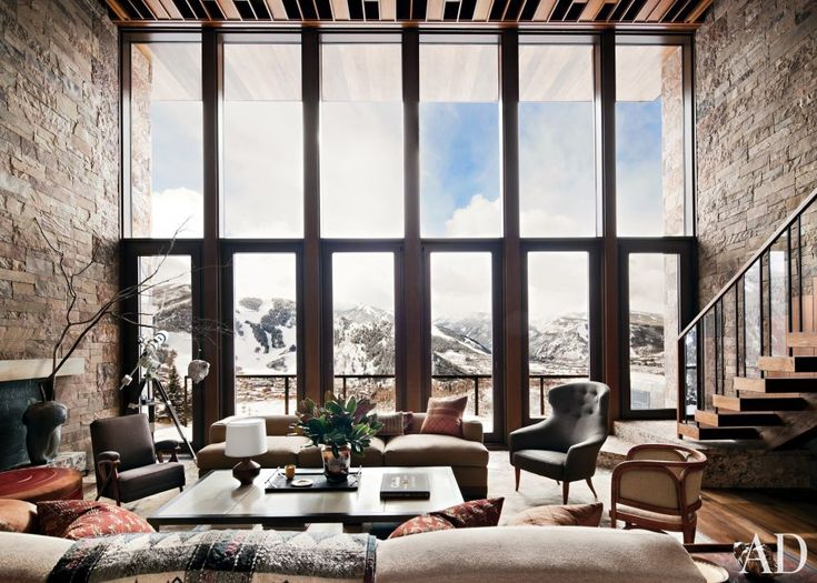In the double-height living room of an Aspen getaway, designer William Sofield conceived the custom-made sofas as well as the blackened-steel cocktail table with an inset parchment top.: Living Rooms, Studios, Skiing Houses, Window, Stones Wall, Modern Rustic, Colorado Home, Piano Keys, Architecture Digest
