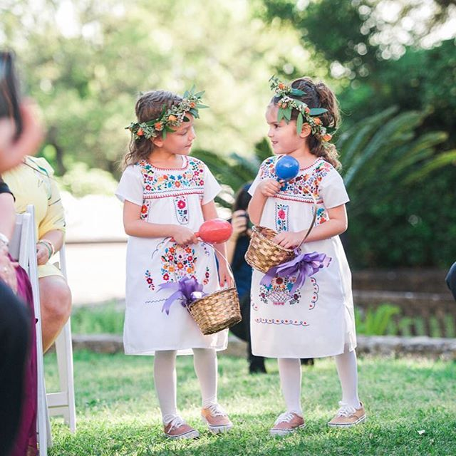 Flower girls in a Mexican theme wedding at McNay San Antonio, Mexican dress