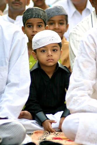 Muslim children offering prayers during Eid on the streets of Mumbai