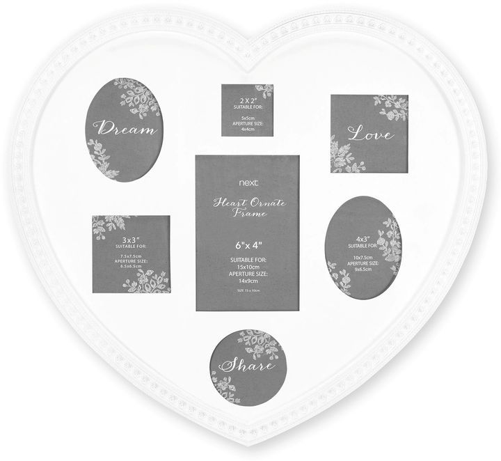 7 Aperture Heart Collage Photo Frame from Next. Gorgeous white heart shaped photo frame for multiple photos > https://api.shopstyle.com/action/apiVisitRetailer?id=532441986&pid=uid8025-34776805-65&site=www.shopstyle.co.uk