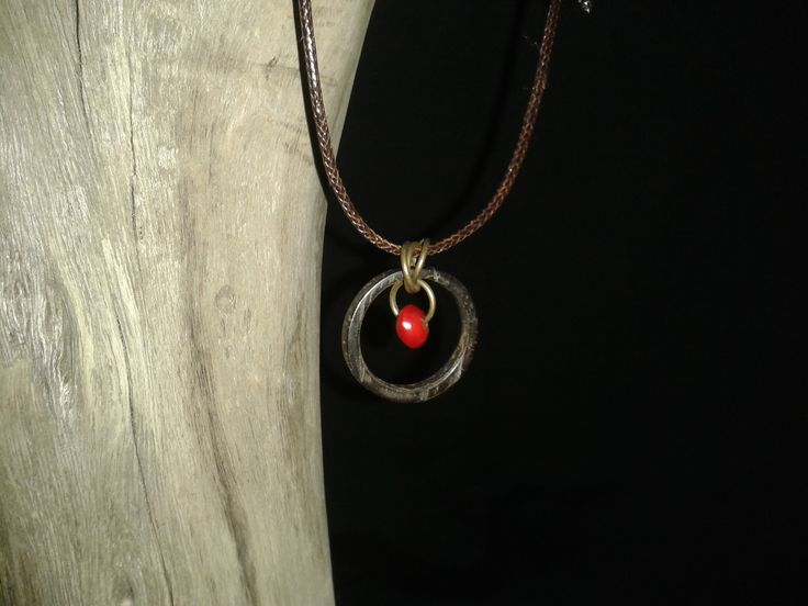Adjustable cord necklace. Pendant is made from a tucum ring with a sage seed dangle.