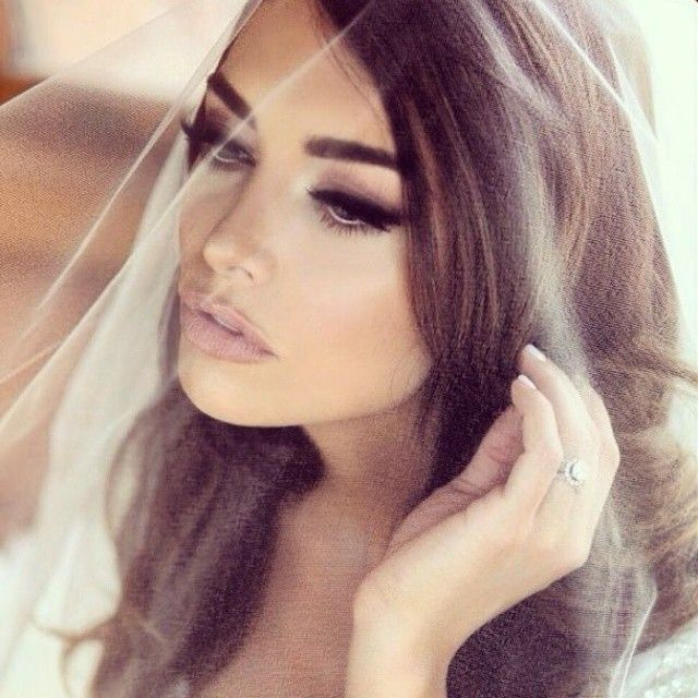 Here's an AMAZING makeup look that any bride can pull off! The bold smokey eye with the nude lip is classic.