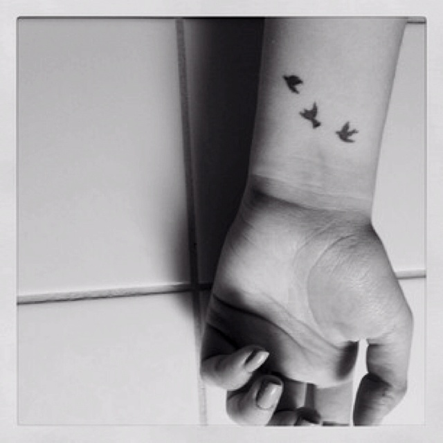 Bird wrist tattoo. But would it eventually be indistinguishable because the detail is so small? Three birds become three blotches..?