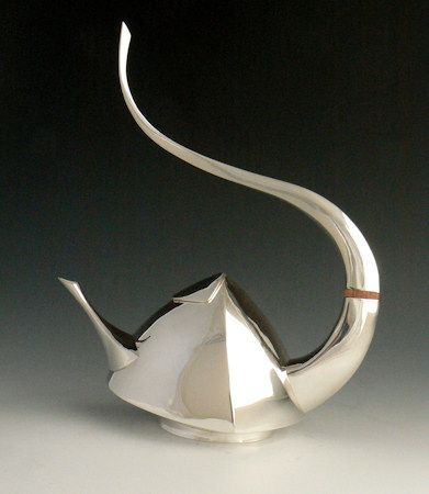 Hand formed Sterling silver teapot. Not stately but a work of art.