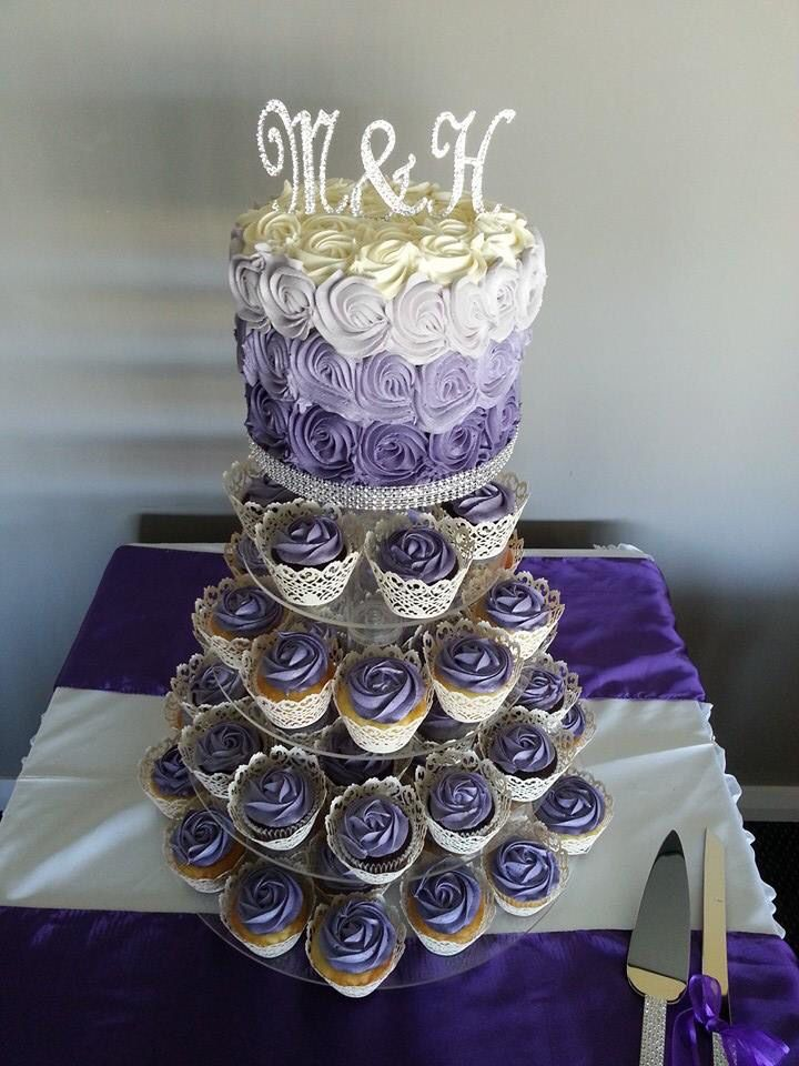 Beautiful wedding cake double barrelled choc mud cake with a 130 (not all on display) mixed choc & white mud cupcakes with buttercream rose swirl Finished off with the Bride & Groom bling intials