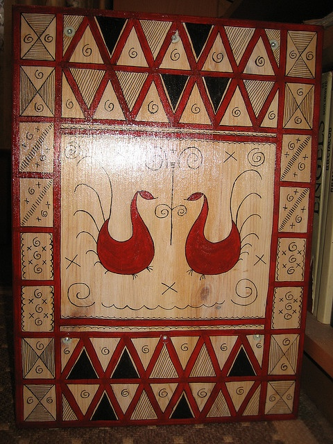 A side of a table painted with Mezen folk art.