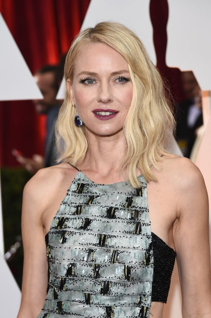 Naomi Watts single-handedly brought some edge to the Oscars with deep berry lips and a cut-out Armani Privé gown.   - ELLE.com