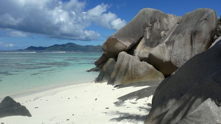 Seychelles. La Digue. Anse Source D'Argent. Turquoise water, white sand and impressive granite blocks.