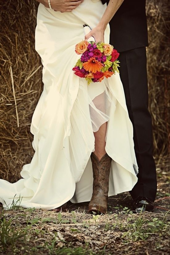 Nothin better than cowboy boots with a wedding dress! #love #countrywedding…