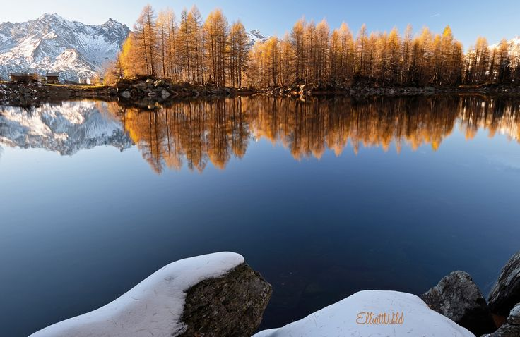 Photograph autumnal reflections at Azzurro lake by ElliottWild on 500px