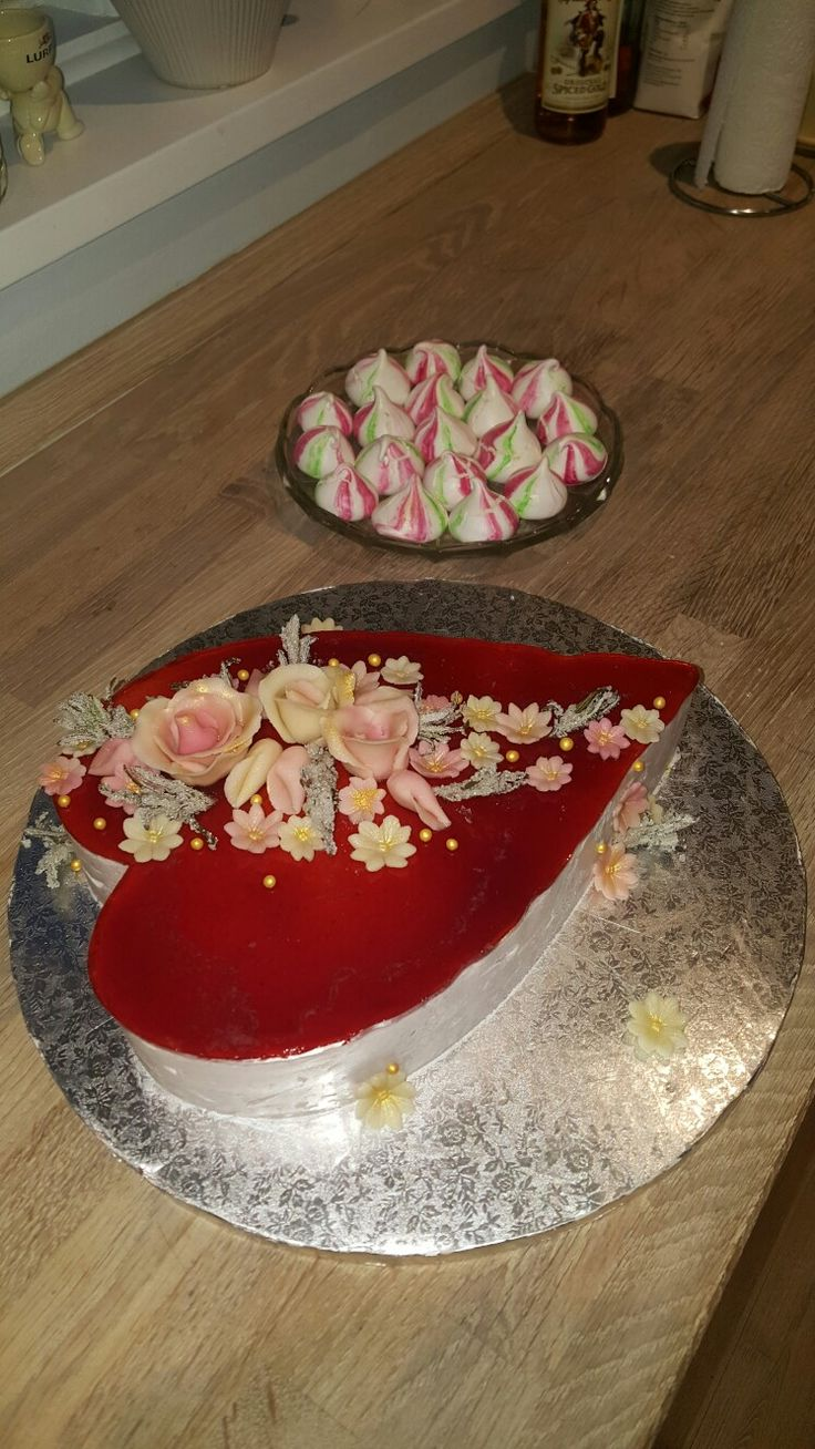 Strawberry and rosemary mousse, with marzipan and white chocolate cake centre, with a white chocolate and lime zest filling. Strawberry and lime juice jelly on top, and decorated with marzipan flowers and crystalized rosemary.
