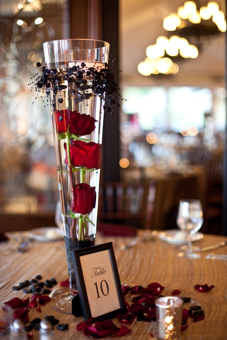 Submerged red roses as a centerpiece work ideas pinterest wedding rose petals and flower - Great decorative flower vase designs ...