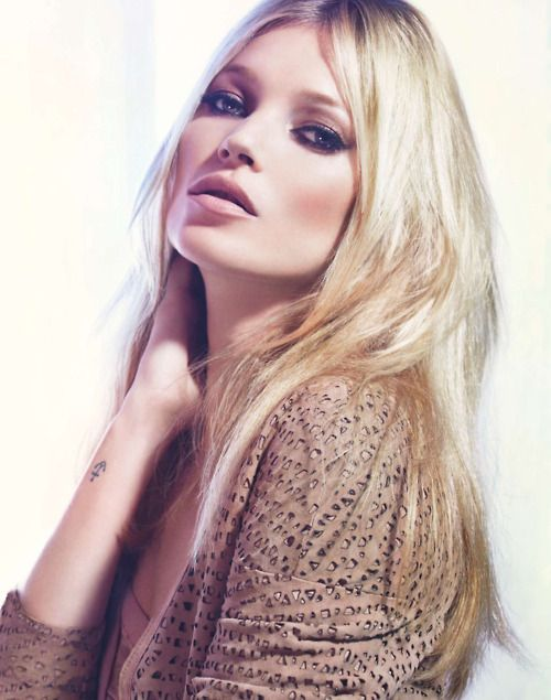 Kate Moss, the worlwide known fashion model, with her signature long blonde hair