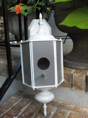 Bird house from old front door lamp. I am going to do this!   ***Made two of these from dollar yard sale porch lights 4-13-12.  I spray painted them  black and then spritzed a bronze color over top and hung them on my fence.  Sherry***