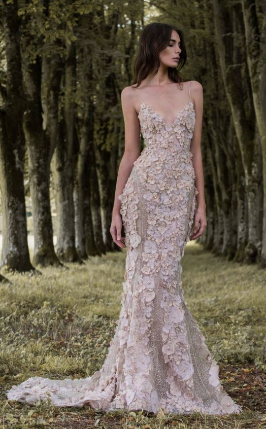 Stunning spaghetti strap fit-and-flare beige floral applique wedding dress with deep v-neckline; Featured Dress: Paolo Sebastian