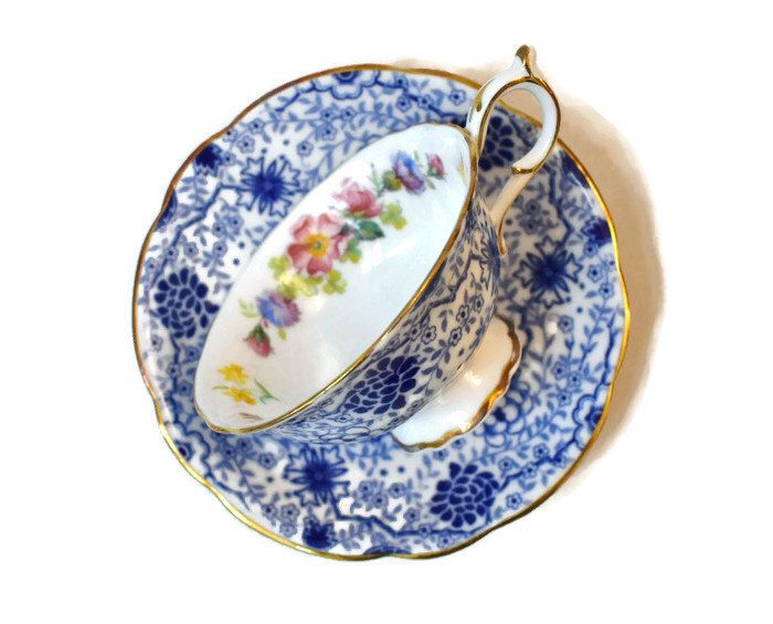 Vintage Paragon Blue Chintz & Pink Yellow Blue Flowers Tea Cup Saucer Set By Appt China Potters To Her Majesty Queen Elizabeth England by AlysVintageAlcove on Etsy https://www.etsy.com/ca/listing/489966677/vintage-paragon-blue-chintz-pink-yellow