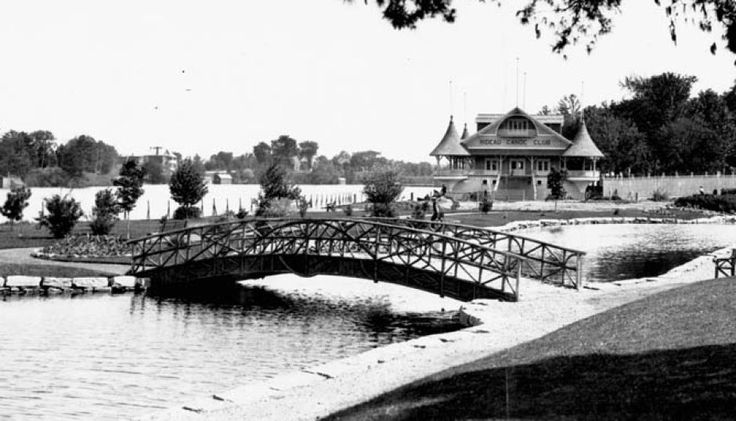 Rideau Canoe Club  A foot bridge and clubhouse sit alongside the Rideau Canal in the Glebe in this undated photograph. The turreted, Victorian-style structure at the foot of Fifth Avenue was the original home of the Rideau Canoe Club, founded in 1902. The building was destroyed by winter ice in the 1940s, leading the club to move to its current location at Mooney's Bay. The spot is now home to the Canal Ritz restaurant while the pond remains, but without the footbridge. #canoespots