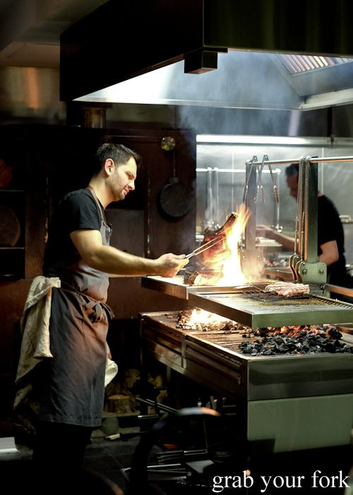 Chef Lennox Hastie cooking the beef rib the woodfired grill at Firedoor, Surry Hills