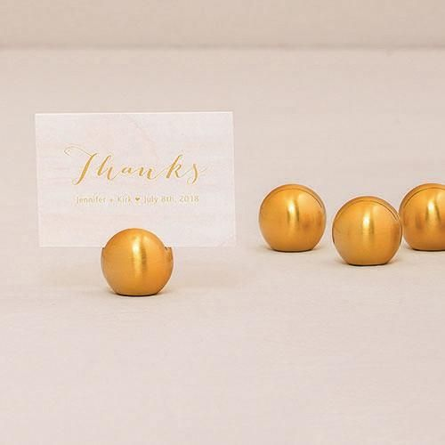 Use the Classic Brushed Gold Round Stationery Place Card Holder to display place cards, table numbers or other small messages intended for your guests. This is