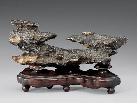 A Scholar's Stone and Ruyi Stand - brush rest .