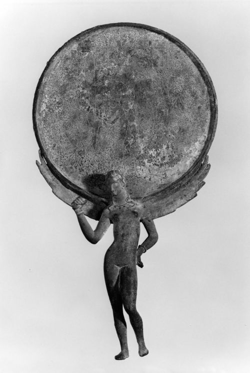 Ancient Etruscan Mirror with Female Figure and Engraved Scene, bronze, 3rd century BC.