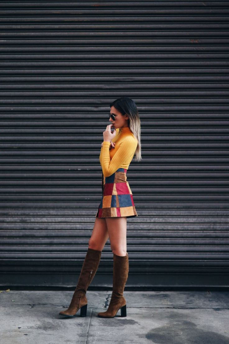A patchwork mini skirt like this is the perfect way to own the trend. Danielle Bernstein looks cute and sassy in this skirt, which she has paired with a  gorgeous mustard top and knee high suede boots for added sophistication.  Skirt: Asos, Top: Topshop, Boots: Zara.