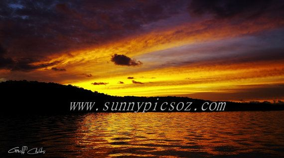 Sunset Seascape Photo over water and through by GeoffsSunsetPics, $5.90