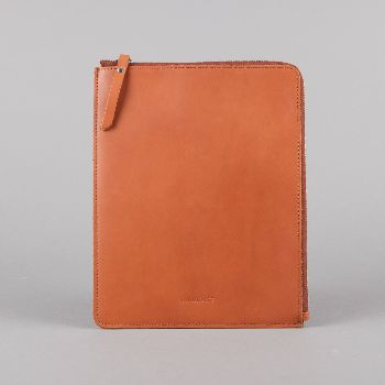 Sandqvist Bengt Ipad Case In Cognac Brown: A classic and timeless iPad case in cognac brown, vegetable tanned leather.   -Zipper closure from YKK -Grey lining and padding for extra protection