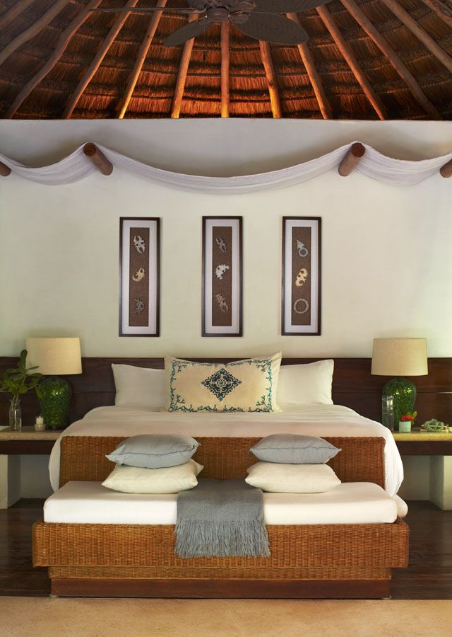 Whicker bed frame and draped tapestry creates the exotic vibe of the jungle  villa at Viceroy