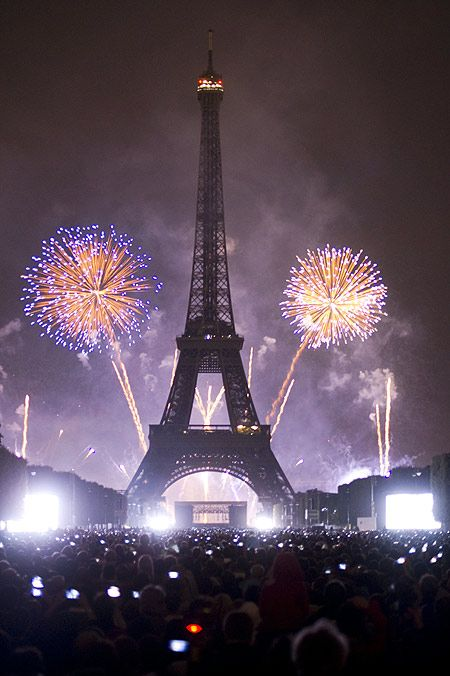 Eiffel Tower is illuminated during the traditional Bastille Day fireworks display in Paris.