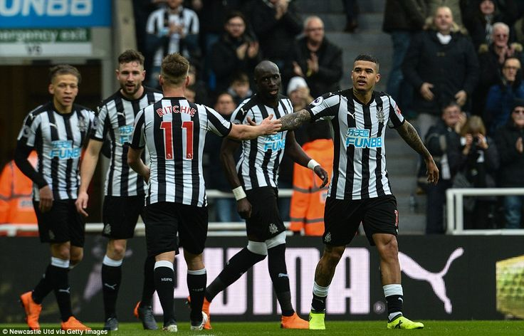 The Newcastle players show their unity as they gather to congratulate new arrival Kenedy for his second goal