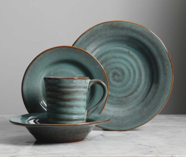 Find your Gibson Elite Mariani Teal Dinnerware Set at Plum Street Pottery. Mariani is a rustic design with teal glaze. Buy online at Plum Street Pottery.