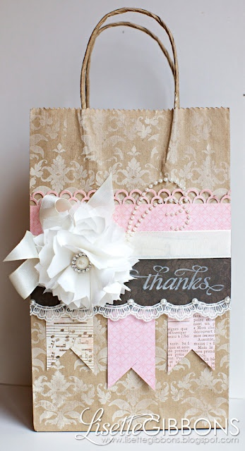 Kraft gift bag with stamping, pink and brown borders and banners, ribbon and shabby flower.