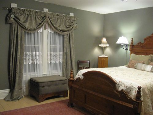 1890s victorian dark olive bedroom inviting and restful bedroom with