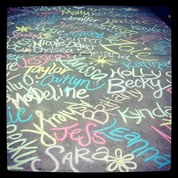 Write all of the new members' names in chalk outside of the house for Bid Day or initiation