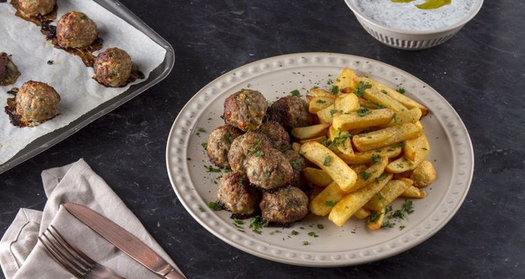 Greek style meatballs by Greek chef Akis Petretzikis. Make the fluffiest, juiciest meatballs with ouzo and a great combination of herbs and serve with tzatziki!