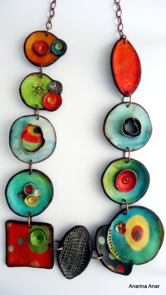 Polymer clay necklace. - Unique organic shape. - Length from top to bottom: 37 cm. - The ring through which the T-bar is secured, is on the right