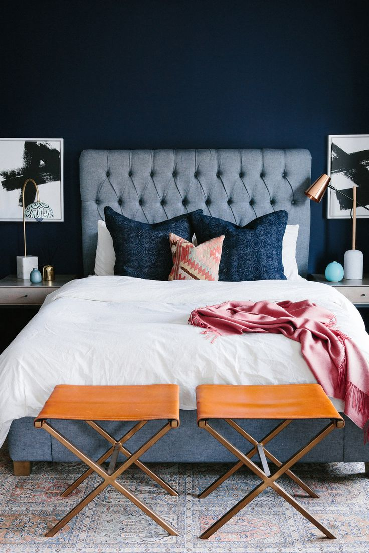 Interior Design by Noz Nozawa | Noz Design | Master bedroom in this glam-eclectic home of a Citizen of the World client: Restoration Hardware denim-linen tufted headboard bed, Parachute and Matteo linens, a Turkish kilim pillow, Anthropologie lamps, CB2 leather stools, a rose cashmere throw, and Heath Ceramics bud vase