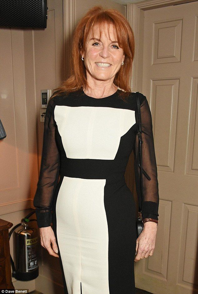 Sarah Ferguson kept her accessories simple with silver hooped earrings and brown leather watch