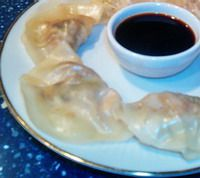 "Steamed vegetarian ""potstickers"" or gyoza dumplings"